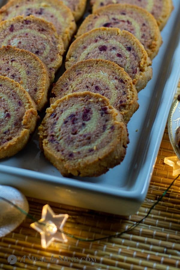 close-up of baked cranberry almond-flour pinwheel cookies