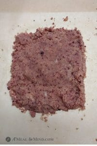 pink dough for cranberry almond-flour pinwheel cookies on parchment paper