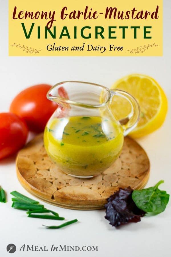 lemony garlic-mustard vinaigrette in glass vessel on trivet
