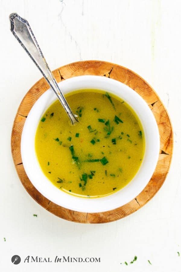 lemony garlic-mustard vinaigrette in small bowl