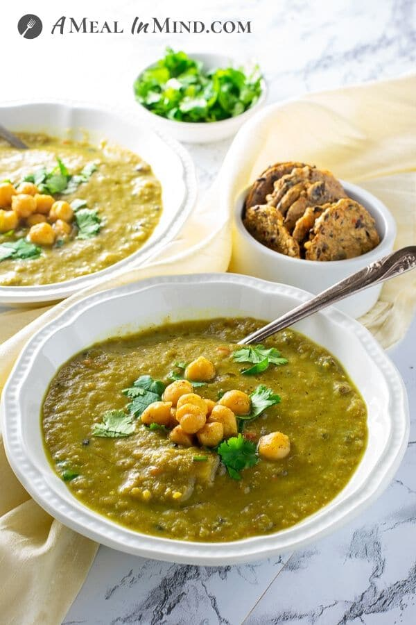 cauliflower wild rice curry soup in white bowls