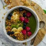 Chia-Greens Peach Smoothie Bowl with fruit garnishes