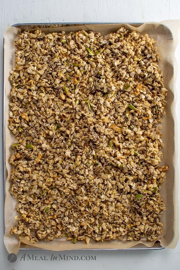 Flax hemp granola with rice Crisps in pan ready to bake