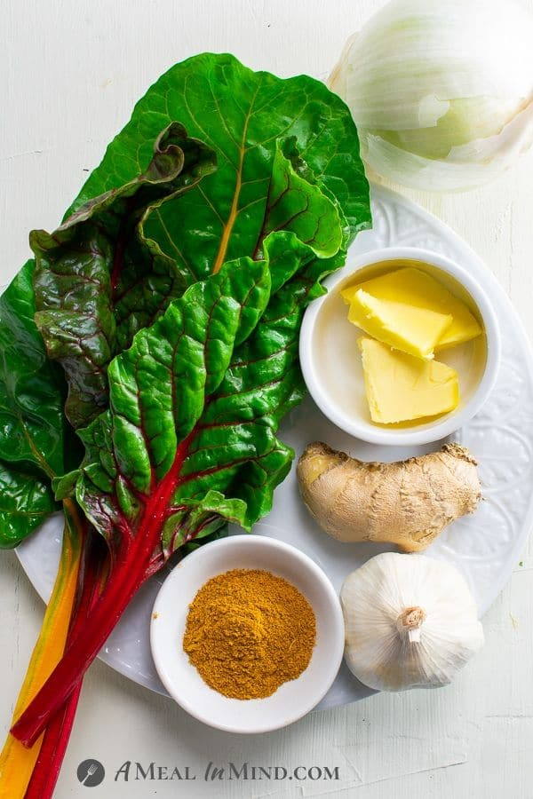 Instant Pot Swiss Chard Saag ingredients on white plate