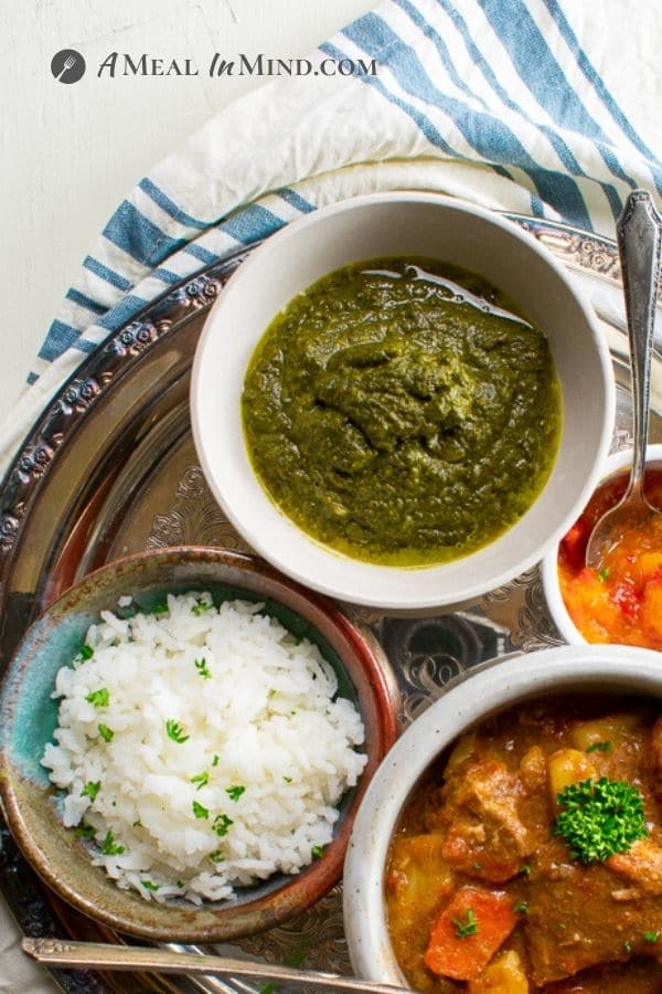 Instant Pot Swiss Chard Saag with rice and lamb korma in bowls