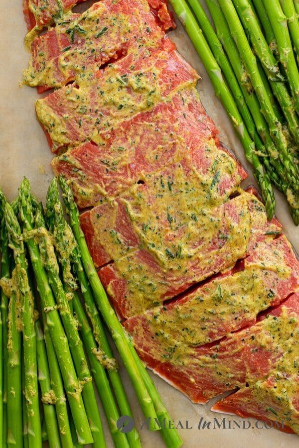 Pecan Mustard Salmon with Asparagus on baking pan
