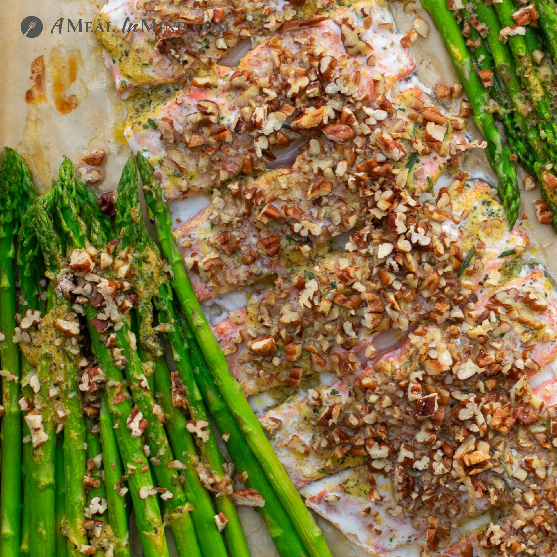 Pecan Mustard Salmon with Asparagus close-up on baking sheet