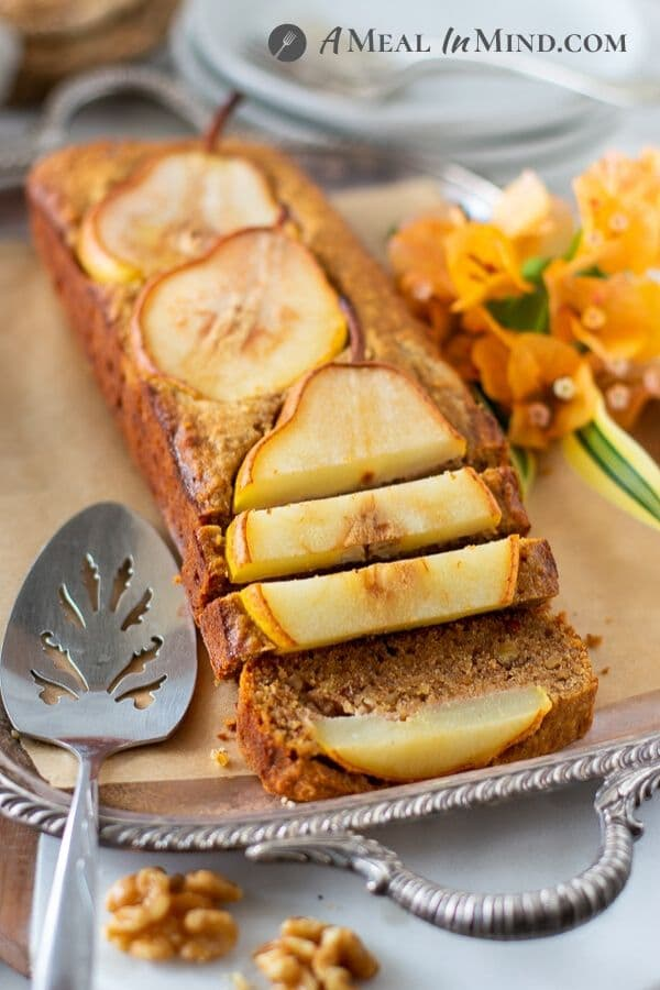 Walnut-Ginger Pear Bread sliced and ready to serve on tray