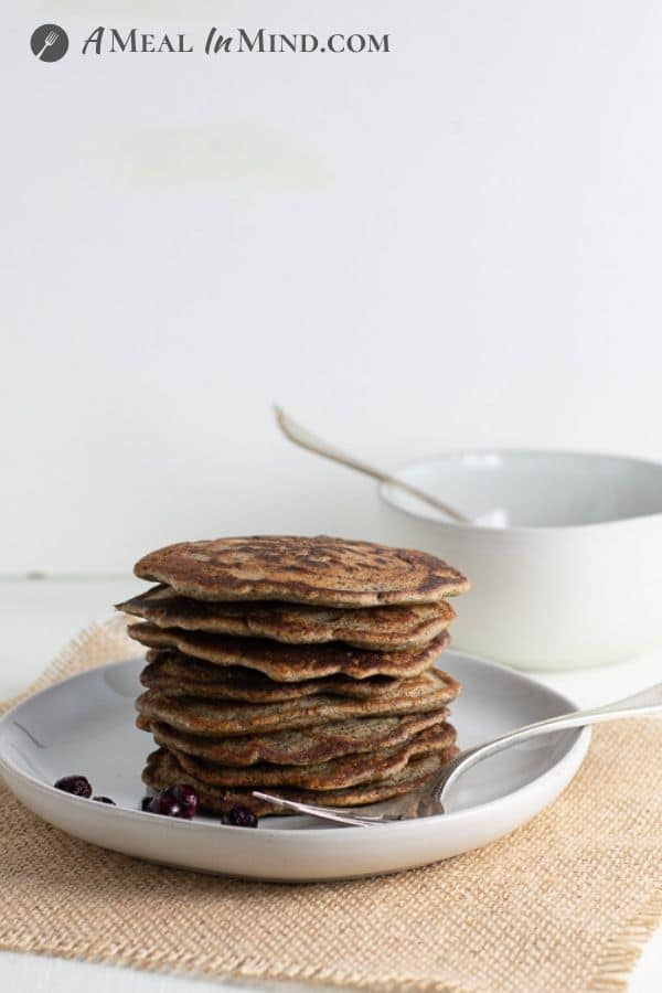 buckwheat currant pancakes stacked on white plate
