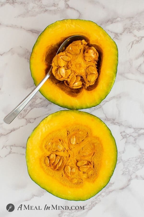 Kabocha Squash cut in half, ready to remove seeds