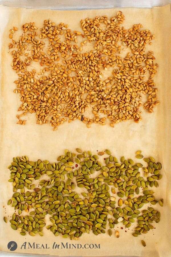 Three-Seed Salad Topper seeds spread onto parchment paper