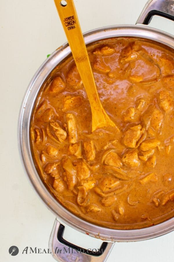 One-Pot Butter Chicken with wooden spoon in saucepan