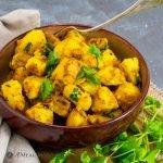 Cumin-Spiced Potatoes in ceramic bowl