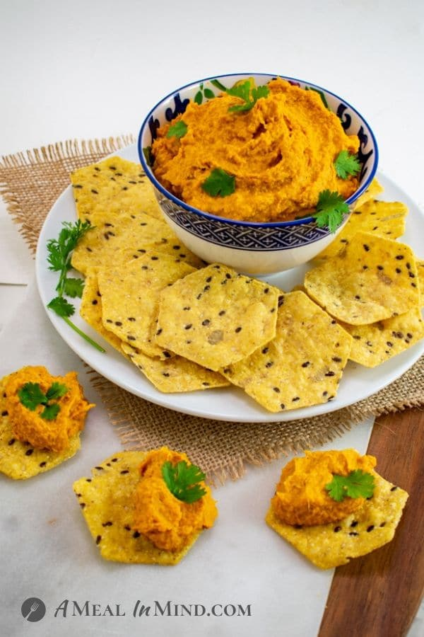 Moroccan Roasted-Carrot Hummus with chips on white plate