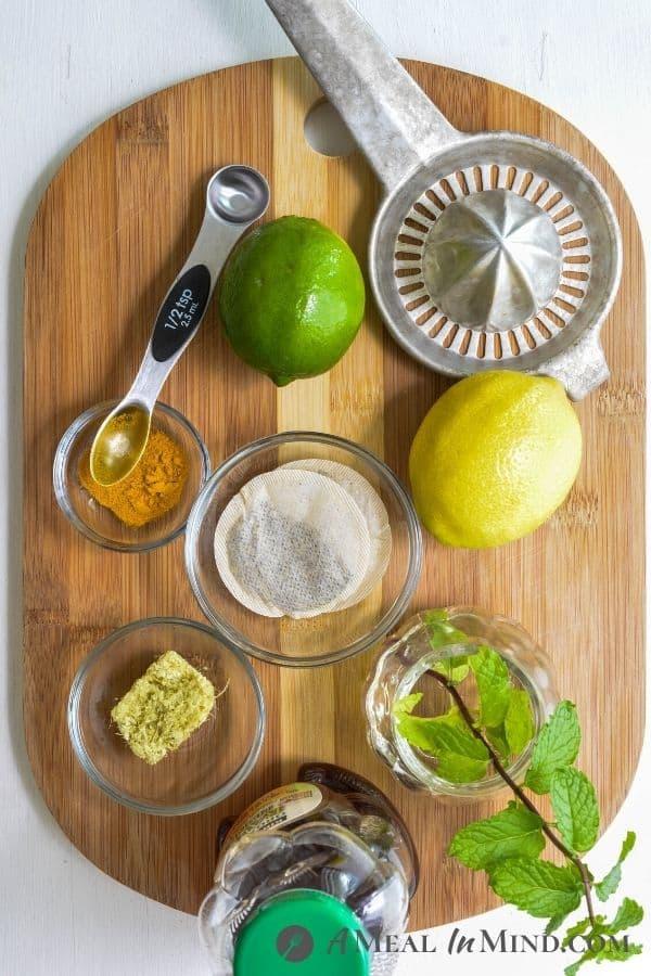 ingredients for Turmeric-Ginger Lemon Tea on wooden board