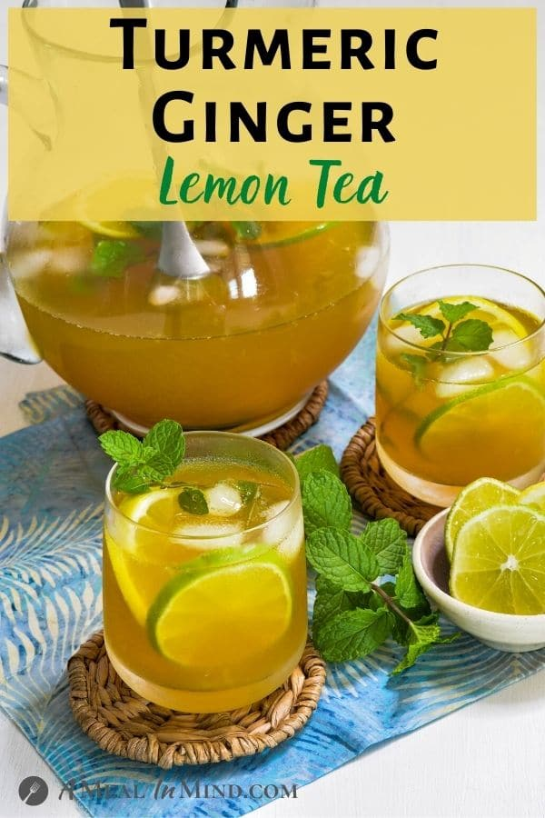 Turmeric-Ginger Lemon Tea in glasses with pitcher on blue cloth