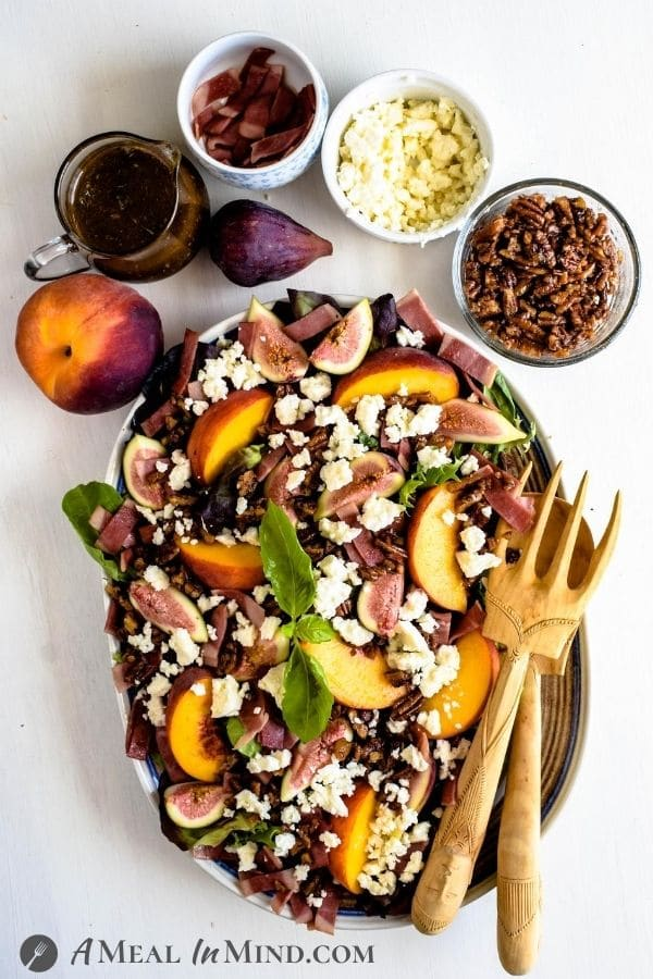 Fig-Peach Pecan Salad with Feta and Balsamic Vinaigrette with toppings in small bowls