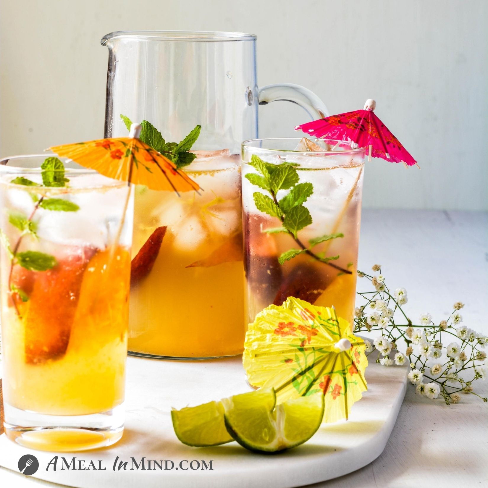 Peach-Ginger Limeade Mocktail side view in glasses and pitcher
