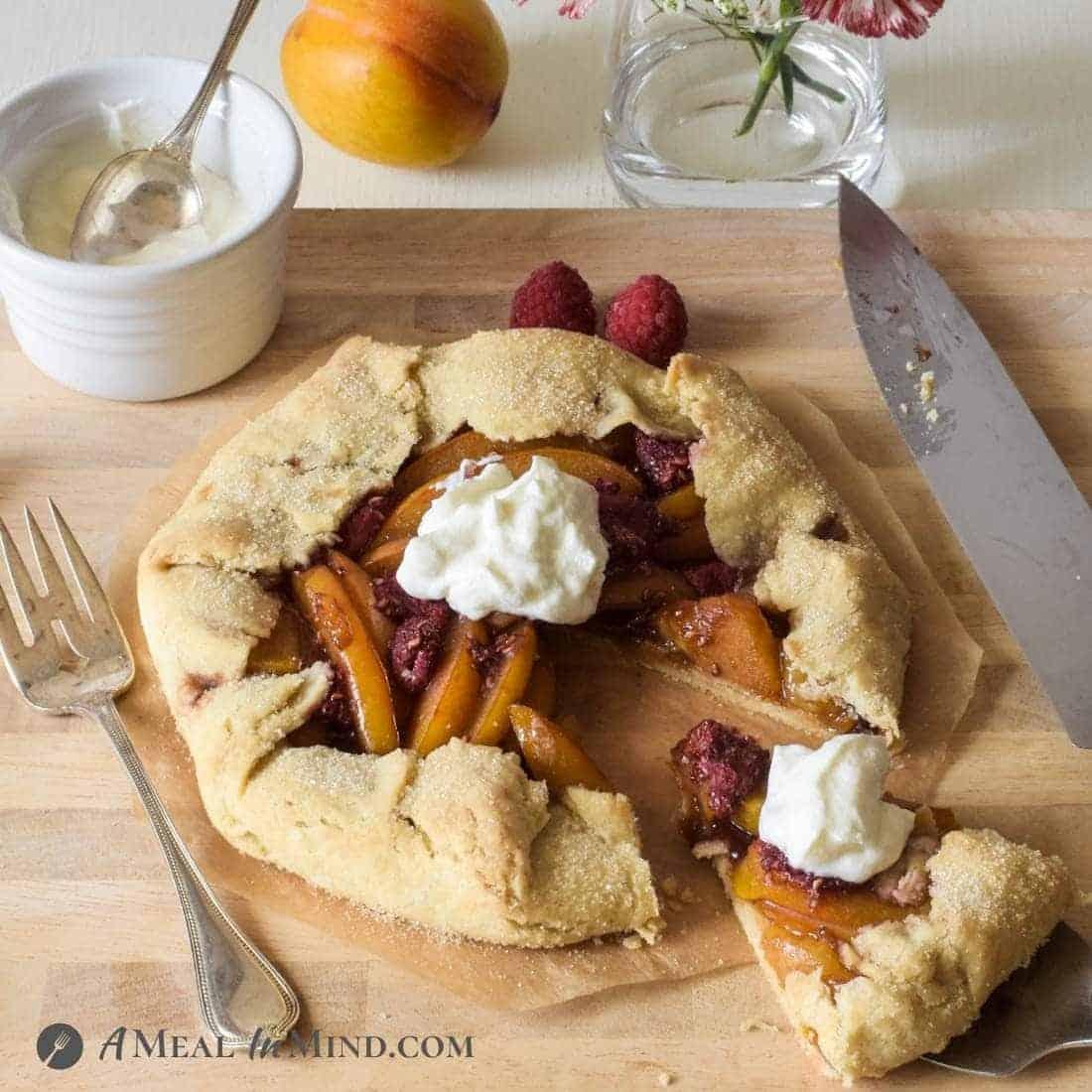 Gluten-Free Plumcot-Raspberry Galette on wooden board
