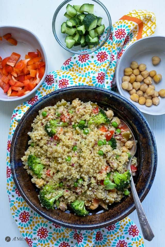Mexican Quinoa Bowl with small bowls of garnishes