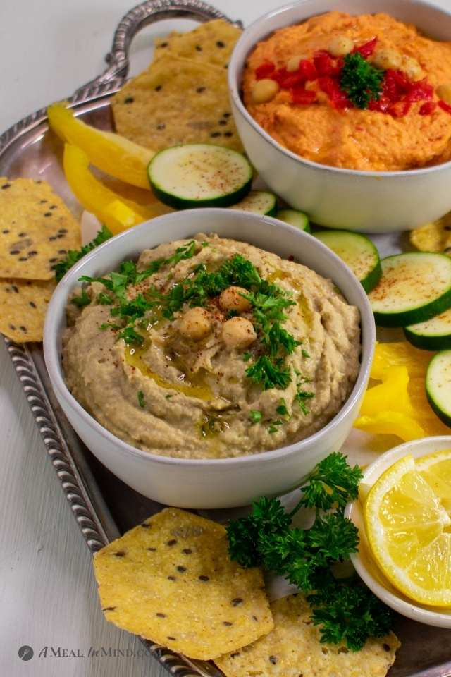 Eggplant and Red Bell Pepper Hummus Platter with eggplant dip in foreground