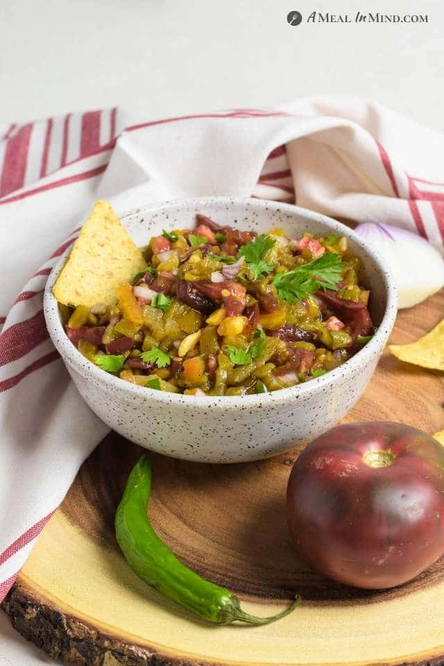 Hatch Green Chile Heirloom Tomato Salsa in bowl on wood board
