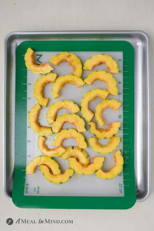 cut delicata squash slices on toaster oven baking tray