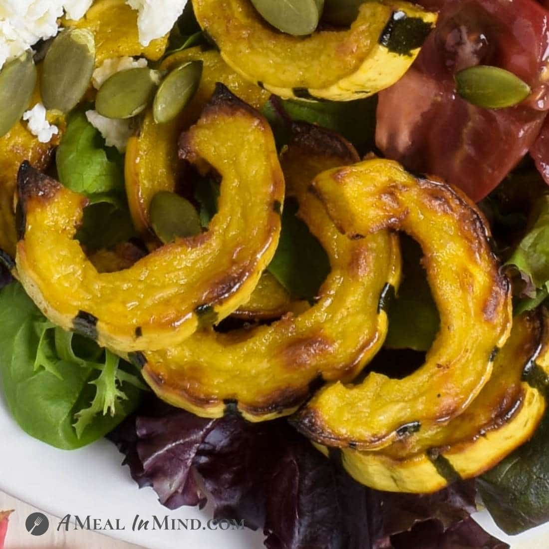 close-up of roasted slices of delicata squash