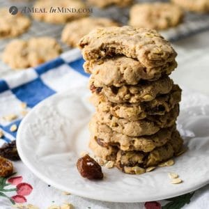 stack of raisin-sweetened oatmeal cookies on white plate