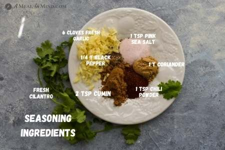 herbs and spices for southwestern roasted sweet potatoes on white plate