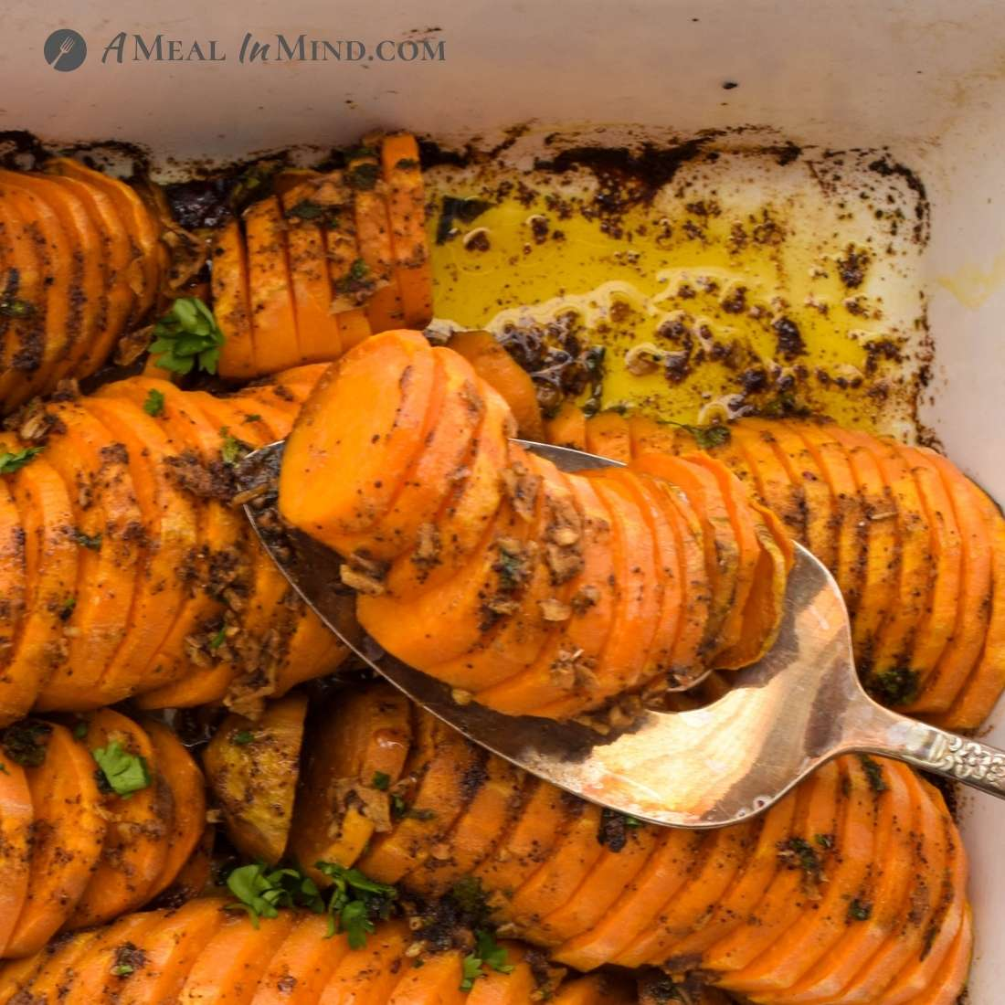 southwestern roasted sweet potatoes being served from roasting pan