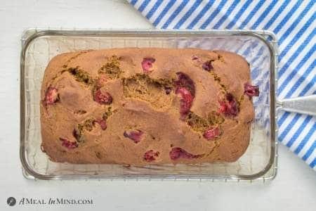 cranberry pumpkin bread in glass baking pan
