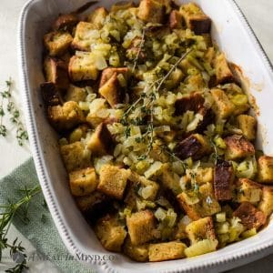 close up of herbed gluten-free stuffing in white baking dish