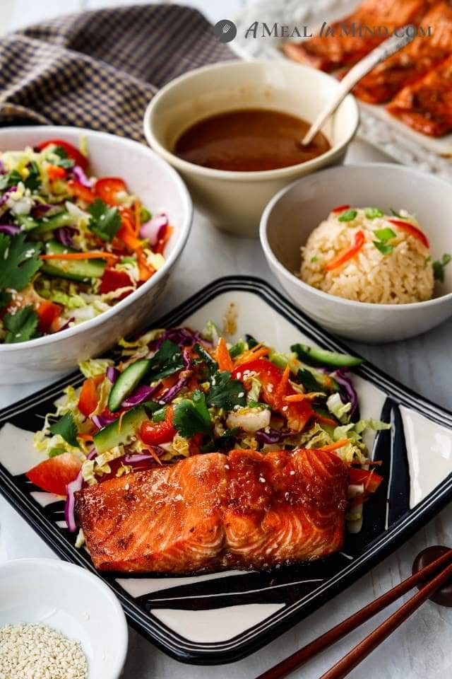 air fryer hoisin salmon with side dishes on plates