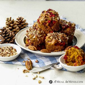 Cranberry-Pecan Pumpkin Muffins on white plate