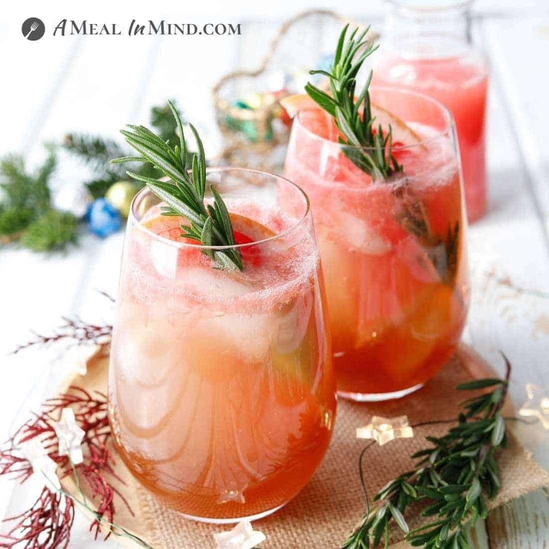 christmas-garnished paleo paloma mocktails with rosemary sprigs